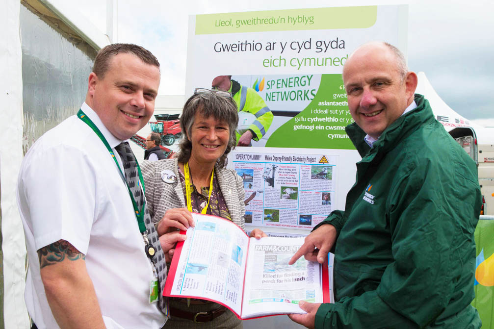 Gail with 2 key managers from Scottish Power standing infront of the A3 displays at The Anglesey Show 2015